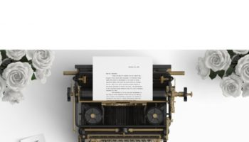 old-typewriter-on-a-desktop-with-white-roses_1104-70