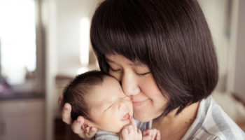 51373438 – asian mother holds her  newborn baby