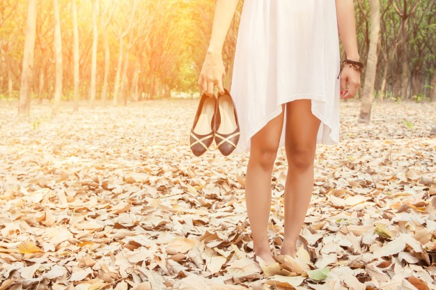 close-up-of-woman-carrying-her-shoes-in-hand_1150-320